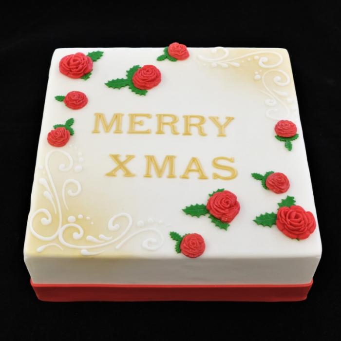 Kersttaarten met decoratie en tekstMerry Xmas