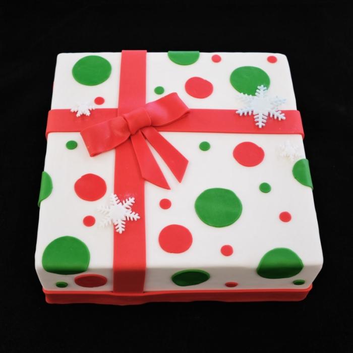Kersttaarten met decoratie en tekstChristmas present